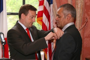 French Consul General Bertrand Lortholary presents Pierre Georges Bonnefil  with the designation of Chevalier in the French Légion d'Honneur by the Republic of France.