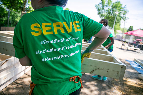 "Freddie Mac volunteers put in ""sweat equity"" with Habitat for Humanity affiliates to help make home possible."