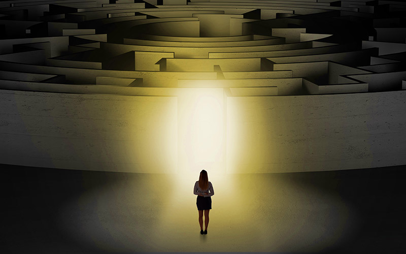 Woman starting a concentric labyrinth