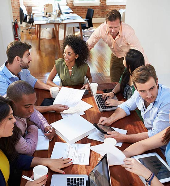 Group Of Office Workers Meeting To Discuss Creative Business Ideas