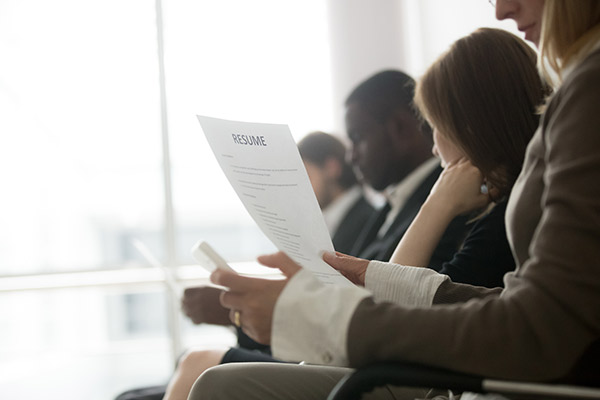 Multiracial business people waiting in queue preparing for job interview
